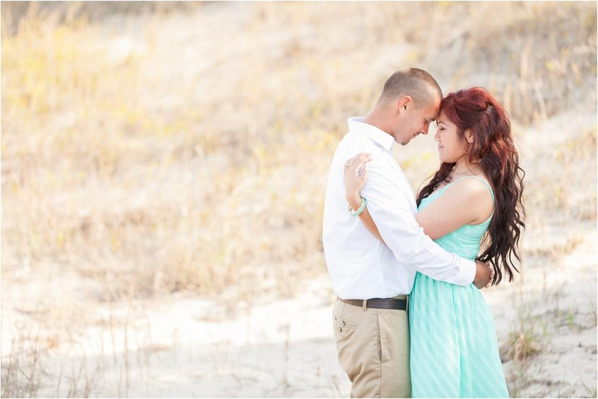 virginia beach oceanfront engagement couple in the sand dunes