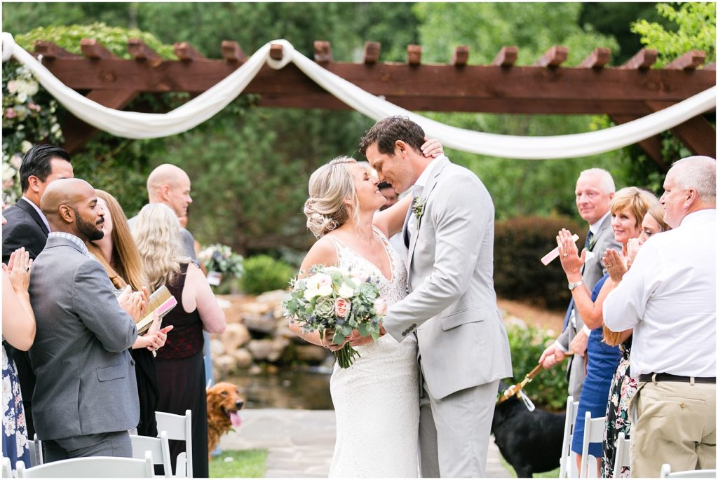 house mountain inn wedding ceremony, bride and groom walking down the aisle, lexington Virginia wedding photographer
