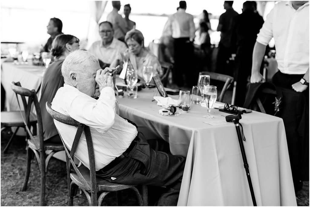candid photograph of grandpa at a wedding reception at The Hermitage Museum and Gardens, Norfolk, Virginia Wedding photographer