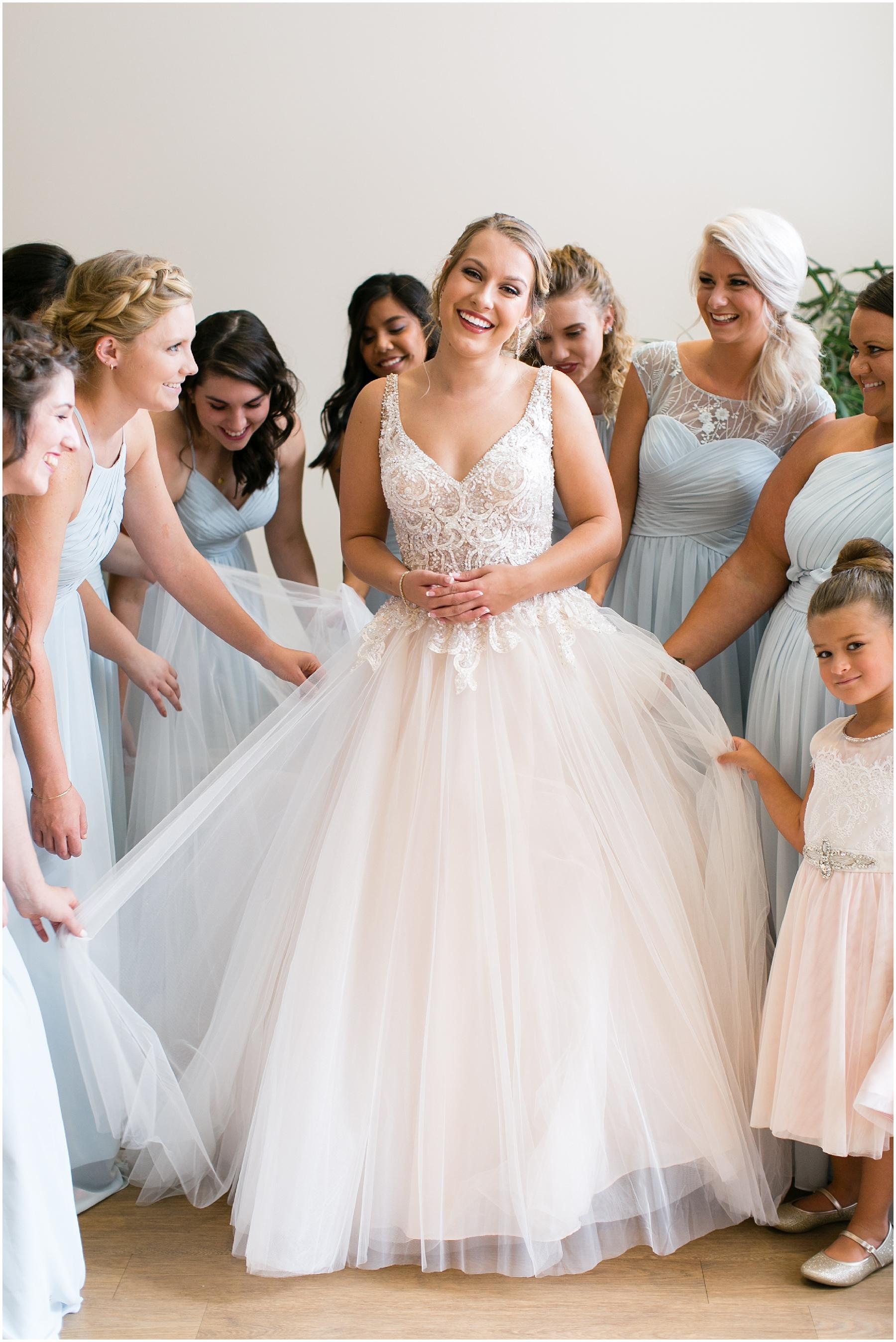 virginia beach wedding photography, candid wedding photography, bride getting into her wedding dress, here and now bridal wedding dress, jessica ryan photography