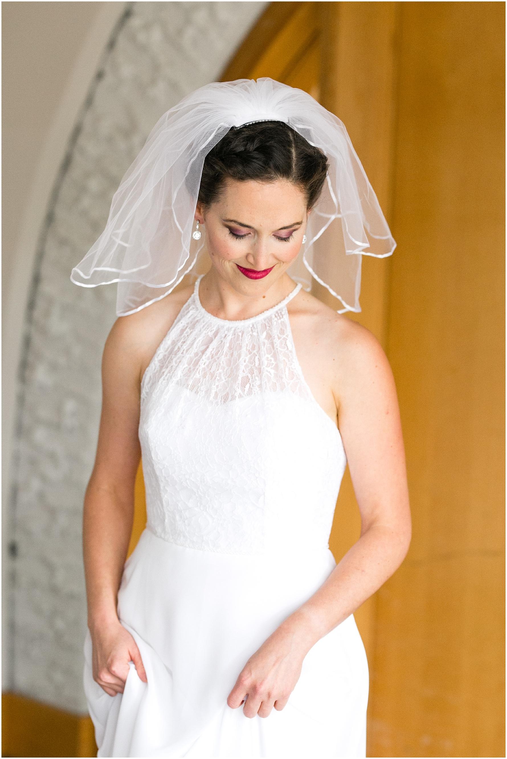 Mariner's Museum Wedding, bride getting into wedding dress