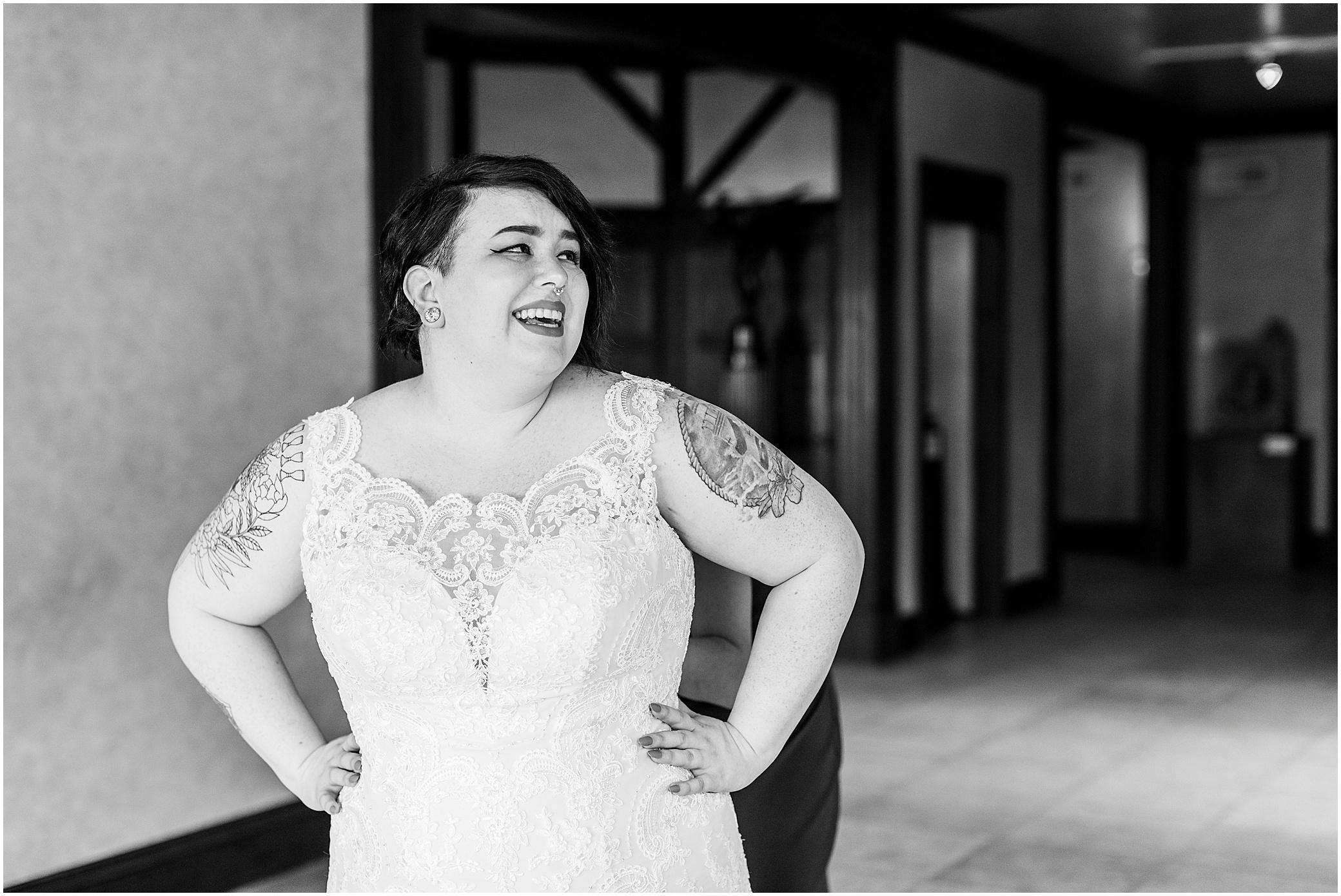 hermitage museum and gardens elopement, studio i do wedding dress, bride getting into wedding dress, tattooed bride