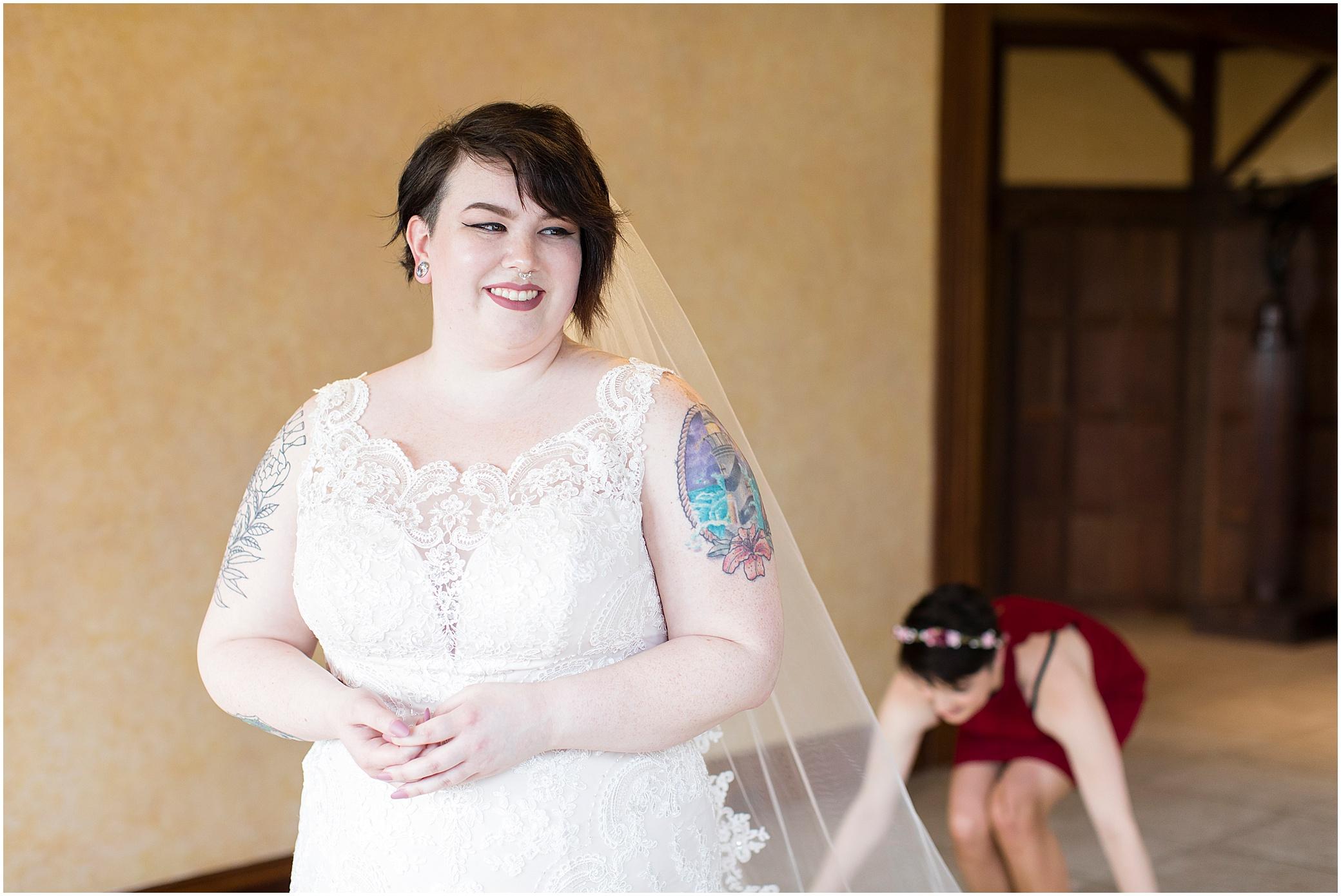 hermitage museum and gardens elopement, studio i do wedding dress, bride getting into wedding dress