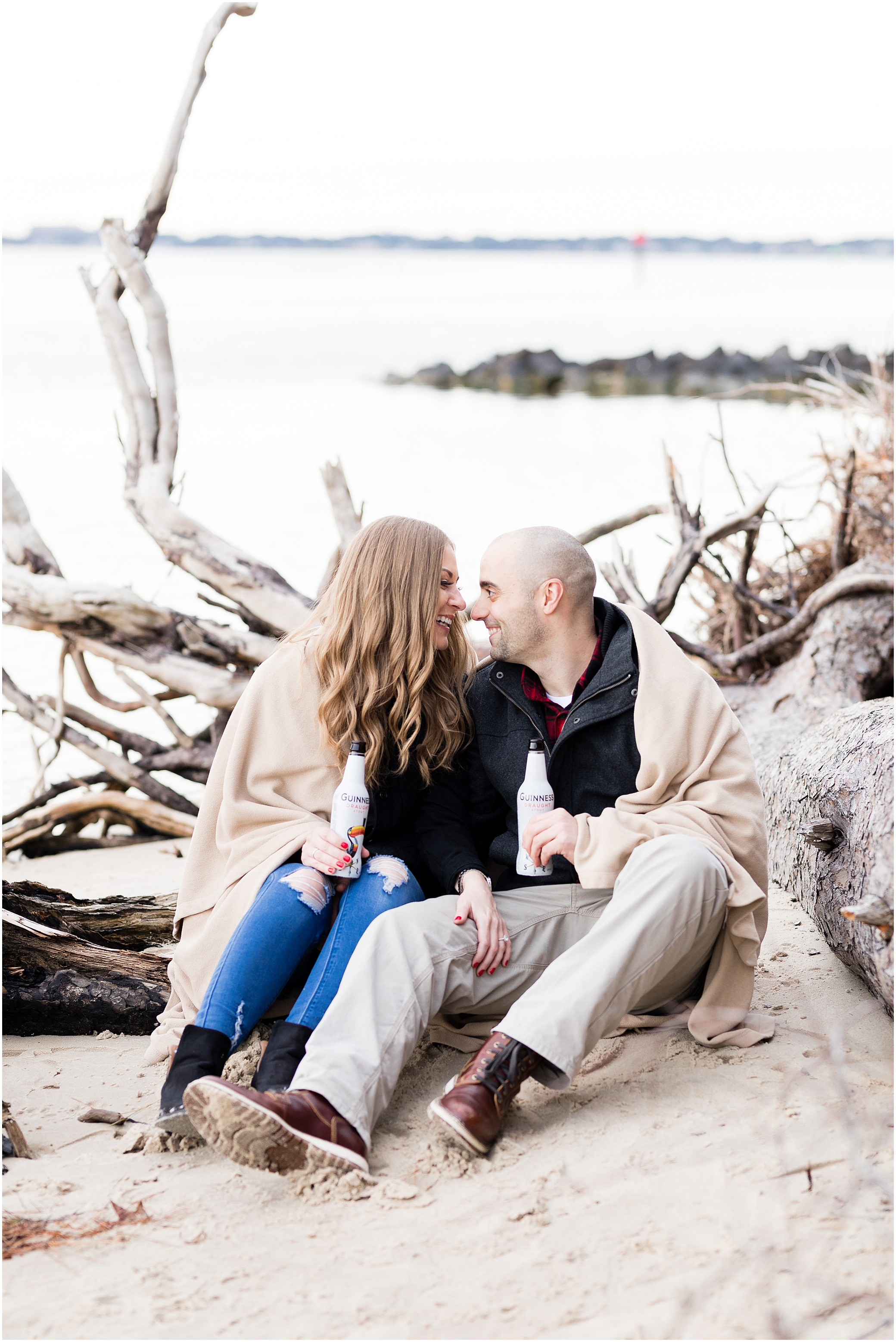 Virginia state park engagement, first landing state park engagement photography, couple on the beach with driftwood