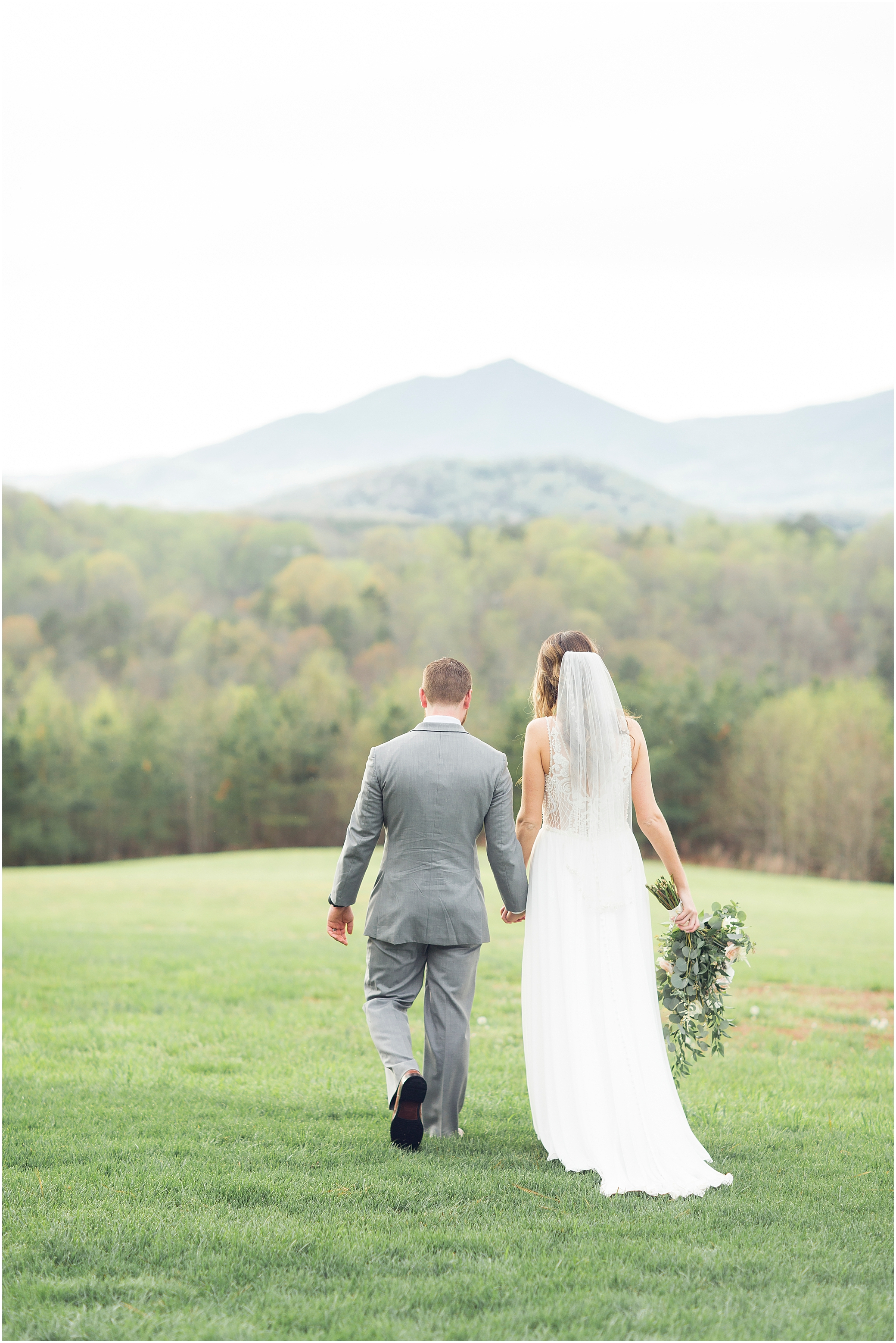 bride and groom walking in front of the mountains at sierra vista wedding