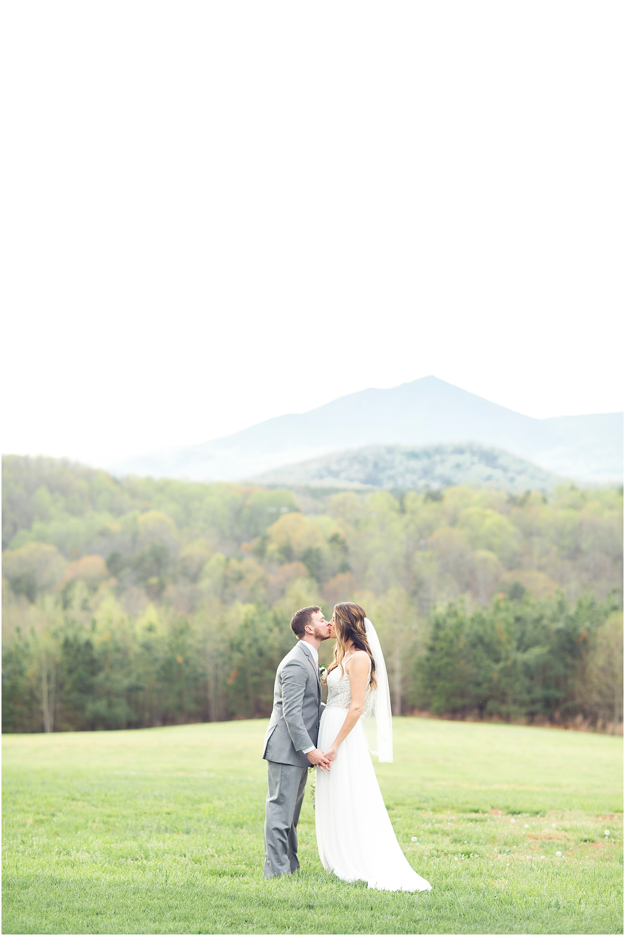 bride and groom kissing in front of the mountains at sierra vista wedding