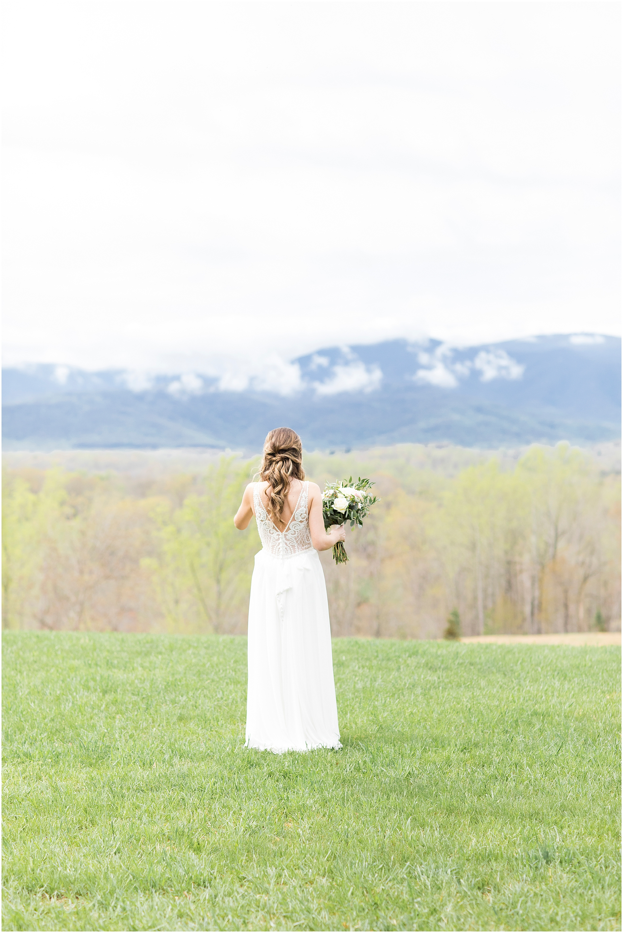 bride looking at the mountain view at sierra vista wedding