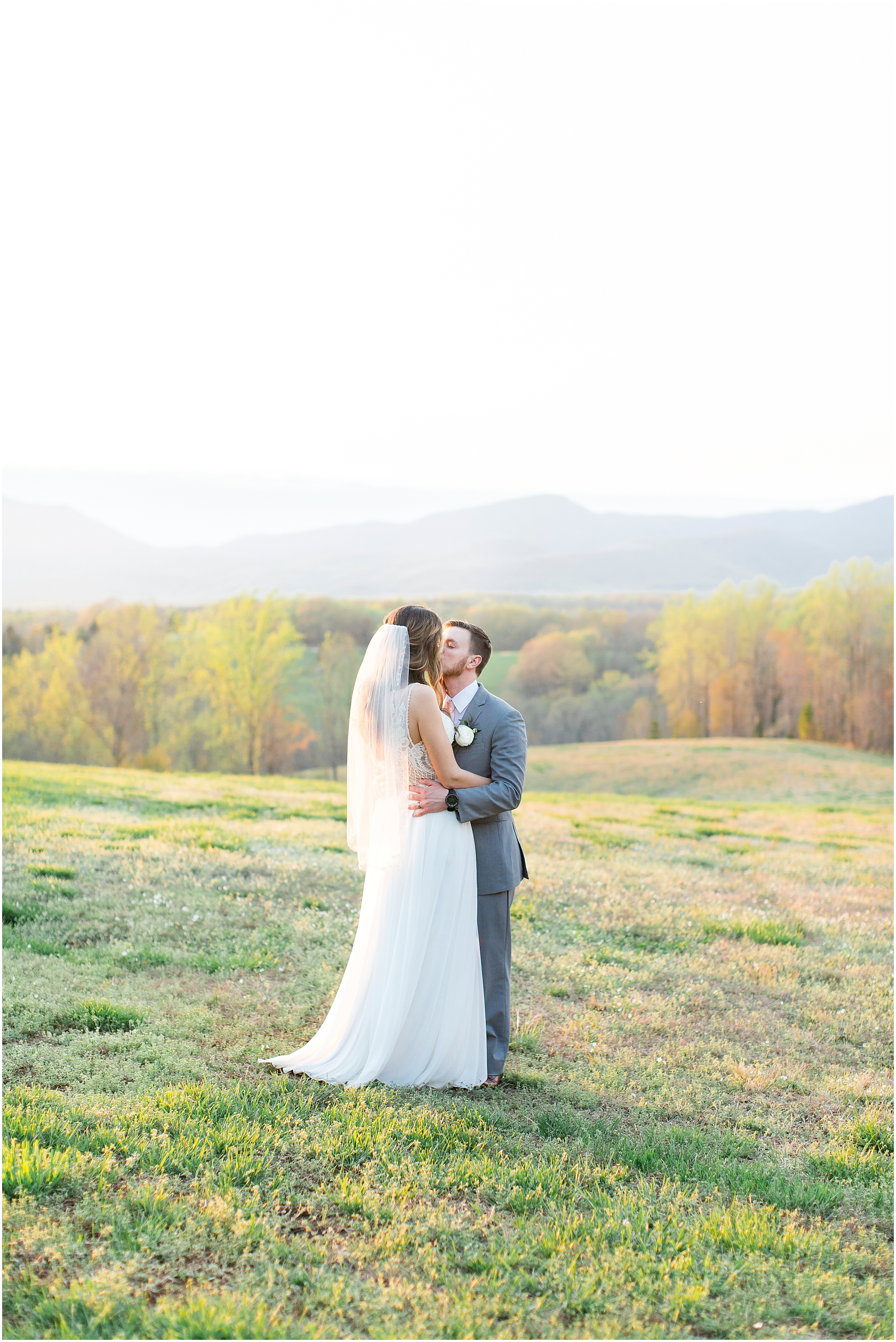 bride and groom kissing in the field at sunset at sierra vista wedding