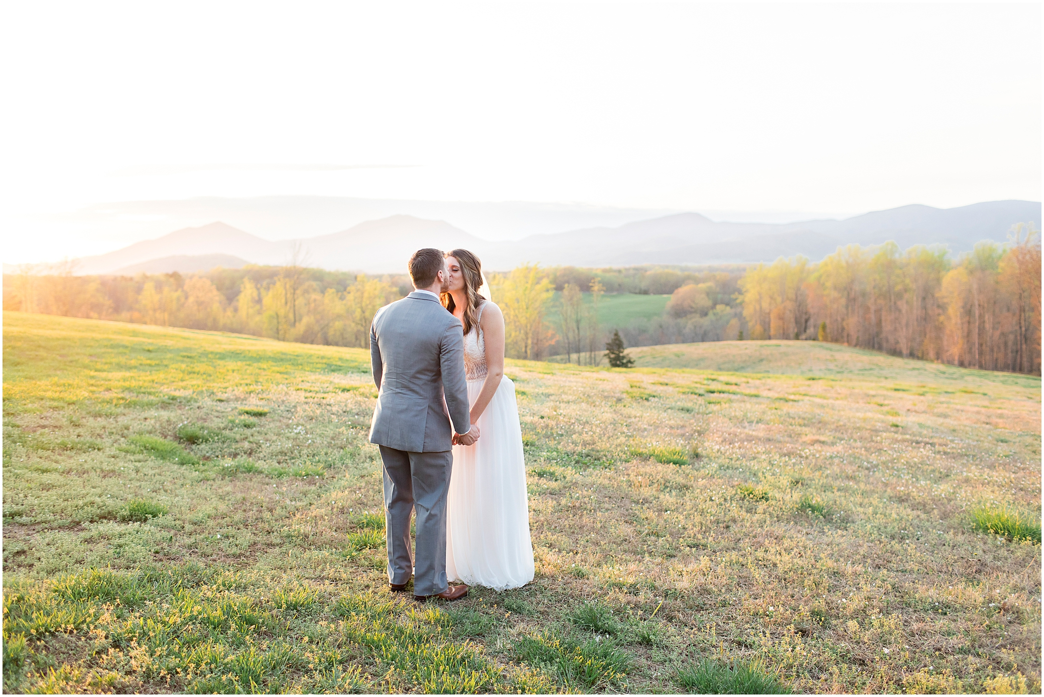 bride and groom kissing at sunset at sierra vista wedding