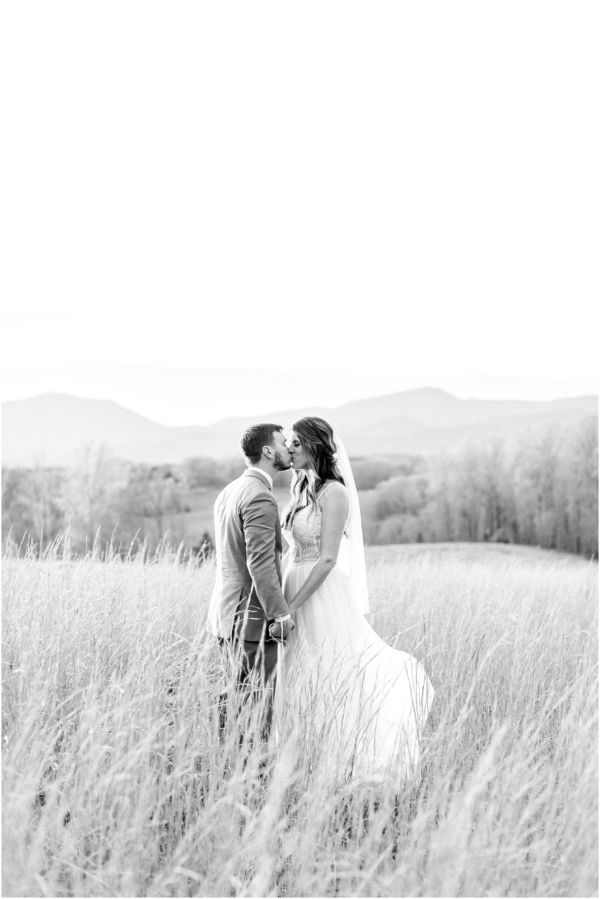 bride and groom in the field at sunset at sierra vista wedding