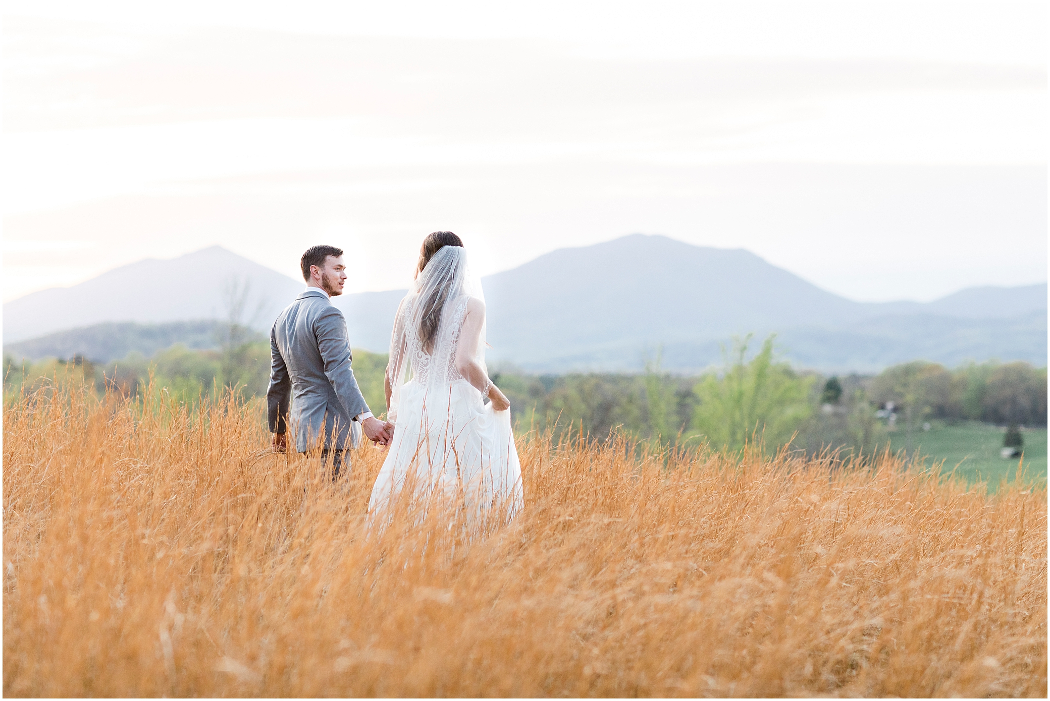 bride and groom in the field with mountain views at sunset at sierra vista wedding