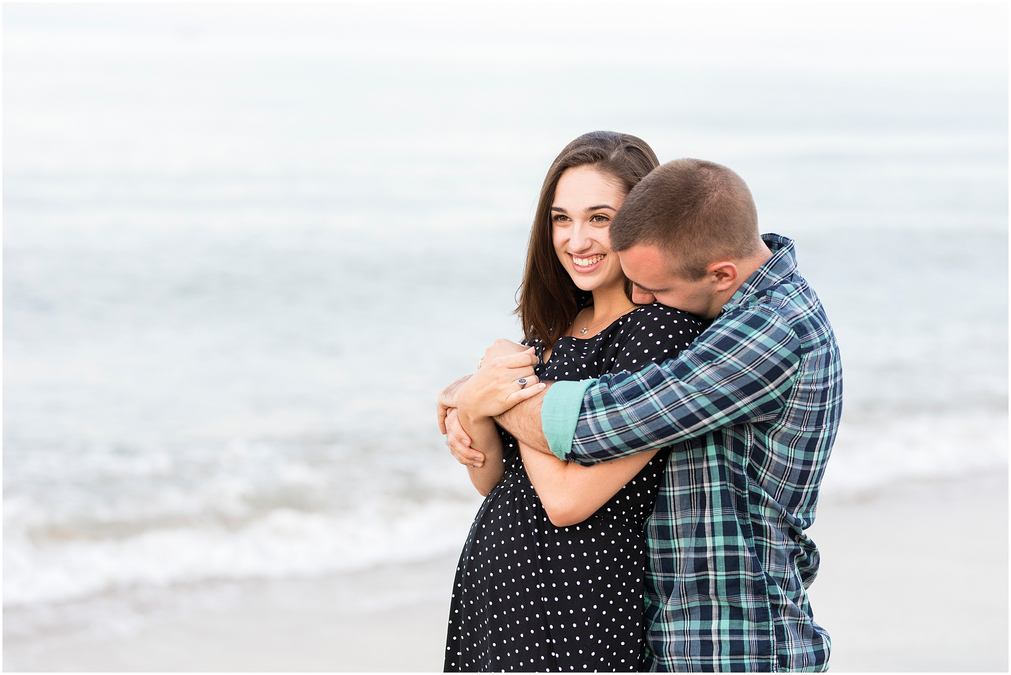 surprise beach proposal, virginia beach oceanfront, guy proposing to girl on the beach