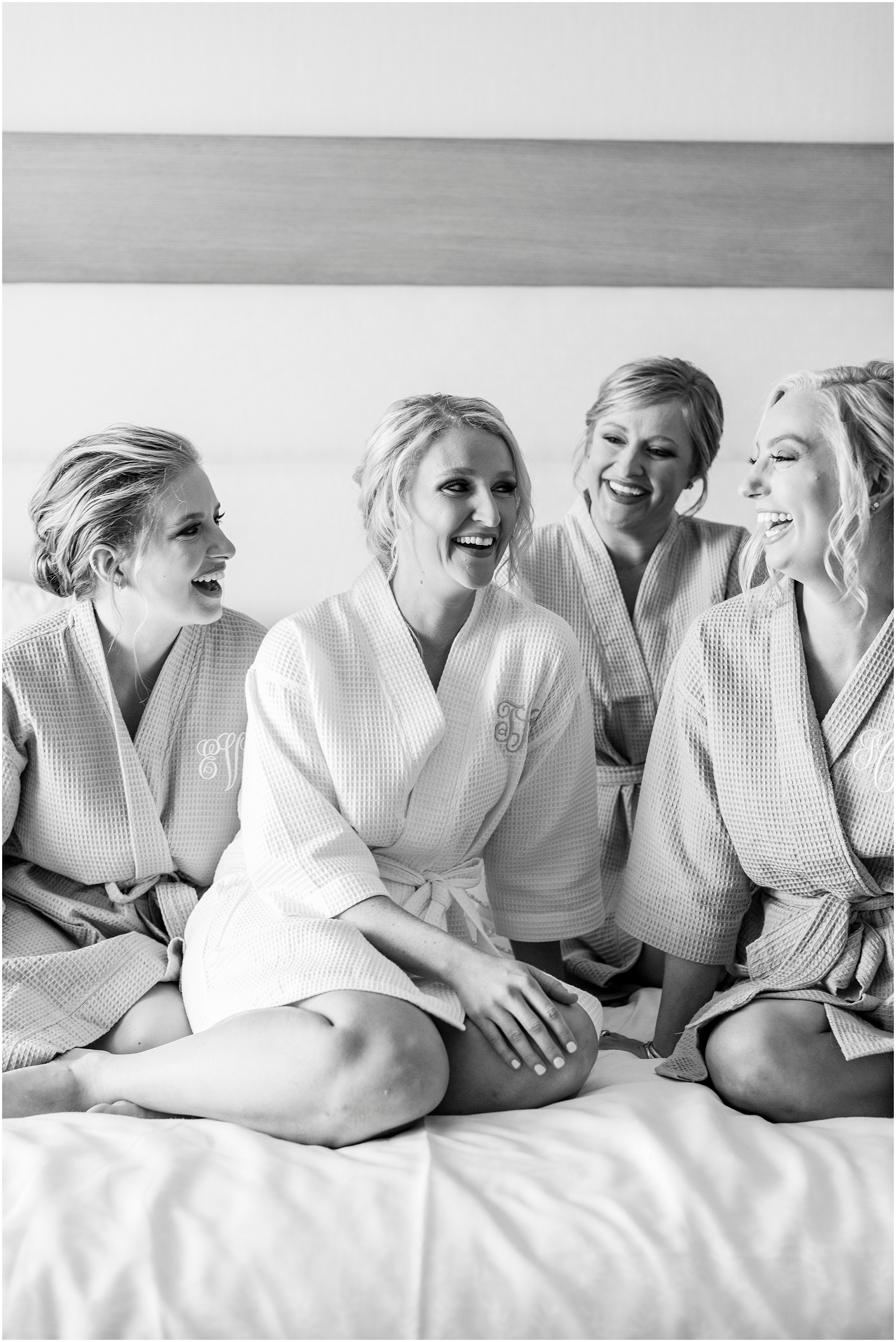 virginia beach wedding photography, bridesmaids laughing on hotel bed