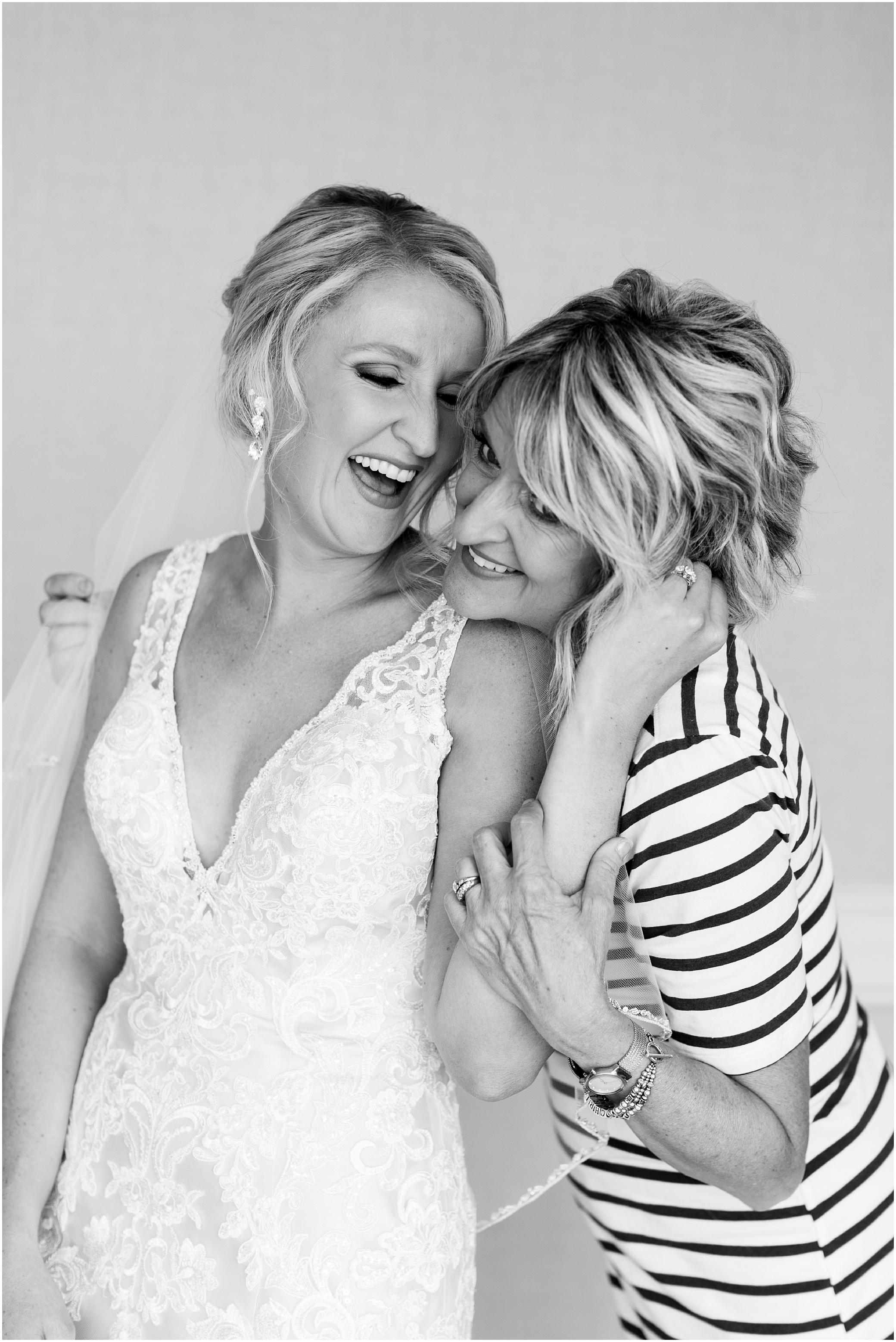 virginia beach wedding photography, mom and bride hugging